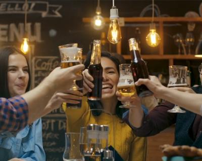 young people at bar celebrating