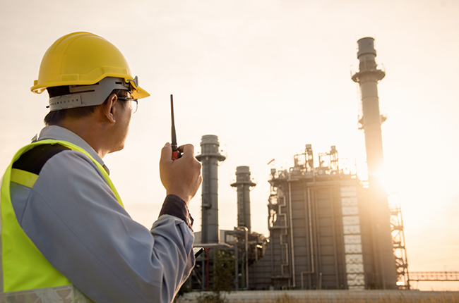 Worker looking at refinery